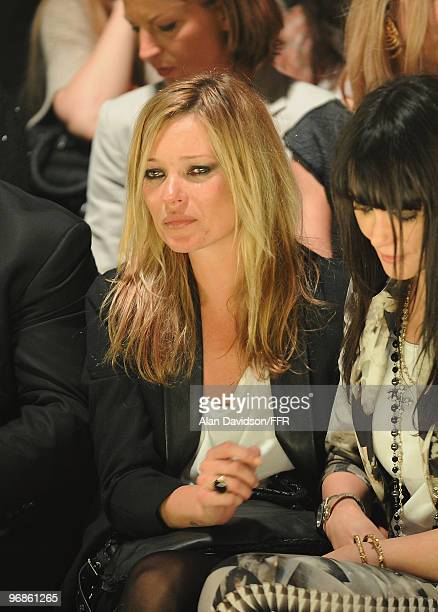 Kate Moss is consoled by Annabelle Neilson while attending Naomi Campbell's Fashion For Relief Haiti London 2010 Fashion Show at Somerset House on...