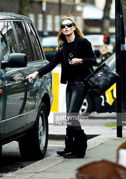 Kate Moss is seen in Notting Hill before meeting an unidentified friend for lunch at Zucca March 10 2004 in London