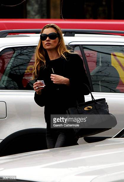 Kate Moss leaves the restaurant Zuuca in Notting Hill March 10, 2004 in London.