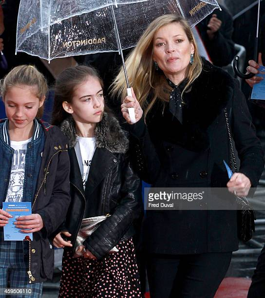 Kate Moss Lila Grace Moss and friend attend the premiere of Paddington at Odeon Leicester Square on November 23 2014 in London England