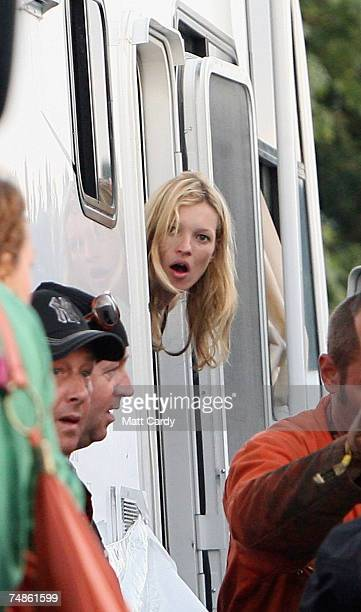 Kate Moss looks out of her motor home at the bikes her boyfriend Pete Doherty has delivered at Worthy Farm Pilton near Glastonbury on June 22 2007 in...