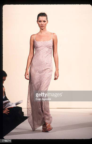 Kate Moss models clothing from the Marc Jacobs Spring 97 collection October 28, 1996 in New York City. Designer Marc Jacobs, who prompted the grunge...