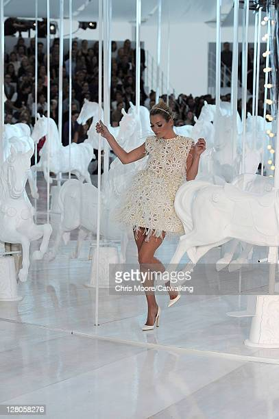 Kate Moss on the runway at the Louis Vuitton Spring Summer 2012 fashion show during Paris Fashion Week on October 5 2011 in Paris France