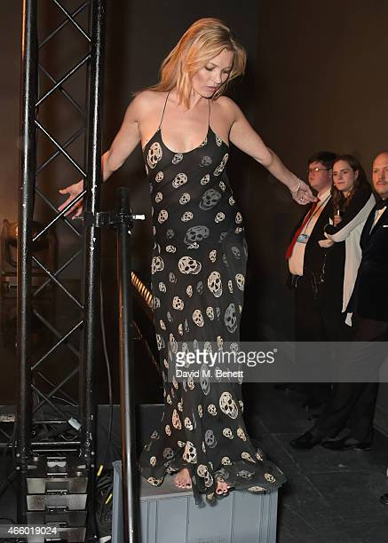 Kate Moss performs with the Michael Clarke dance troupe at the Alexander McQueen Savage Beauty Fashion Gala at the VA presented by American Express...