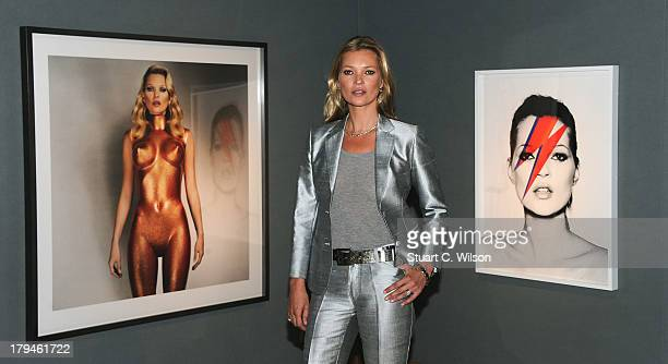Kate Moss poses at a photocall ahead of the 'Kate Moss: The Collection' auction which sees various artworks of the model curated by Gert Elfering go...