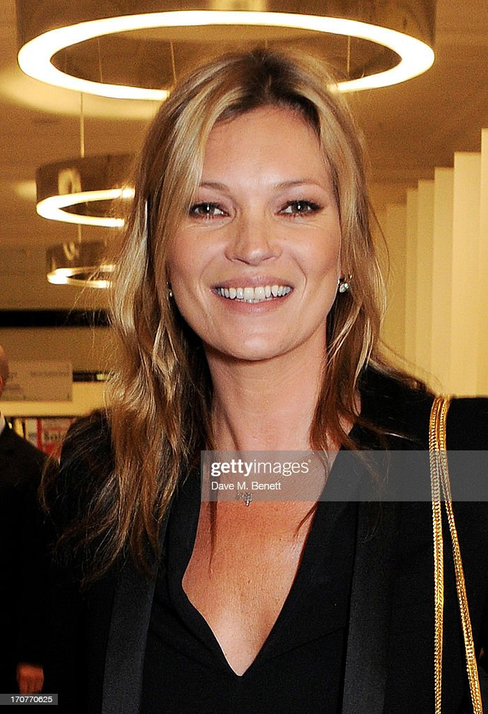 Kate Moss poses at a photocall to unveil a new portrait by artist Chris Levine during the launch of 'Charlotte Tilbury's Make-Up House Of Rock n'Kohl' at Selfridges on June 17, 2013 in London, England.