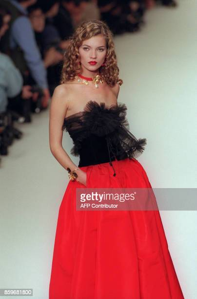 Kate Moss presents a creation by French designer Yves Saint Laurent 09 March 1994 in Paris, during the Autumn-Winter 1994/1995 ready to wear...