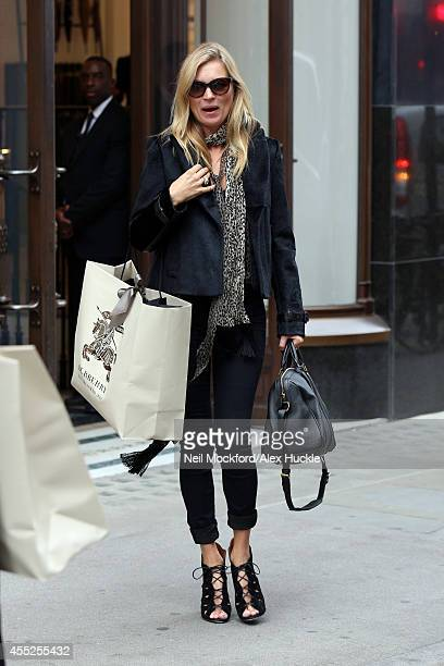 Kate Moss seen leaving Burberry on Regents Street on September 11 2014 in London England