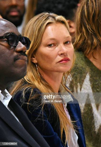 Kate Moss sits in the front row at the Richard Quinn SS22 show & cocktail party at The Londoner Hotel on September 21, 2021 in London, England.