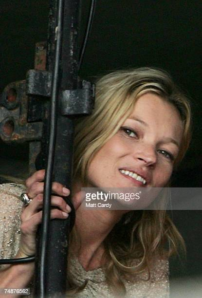 Kate Moss smiles as she watches her boyfriend Pete Doherty perform on The Park Stage at Worthy Farm Pilton near Glastonbury on June 24 2007 in...