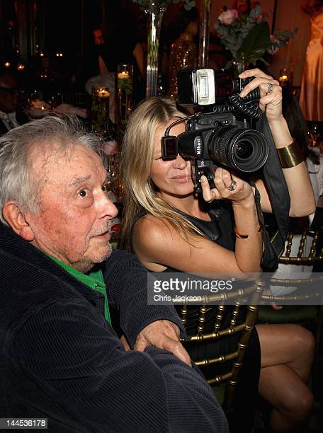 Kate Moss takes photographs as David Bailey looks on at the Marie Curie Cancer Care Fundraiser, hosted by Heather Kerzner at Claridge's Hotel on May...