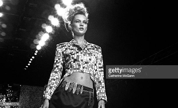 Kate Moss walks the runway at a Todd Oldham fashion show on October 31 1995 in New York City New York