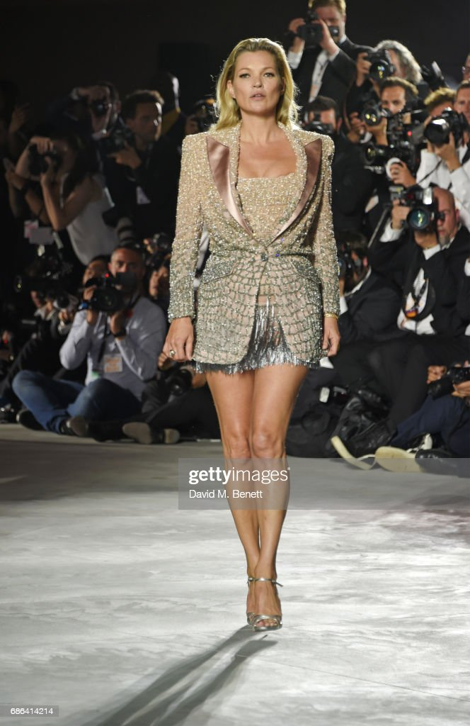 Kate Moss walks the runway at the Fashion for Relief event during the 70th annual Cannes Film Festival at Aeroport Cannes Mandelieu on May 21, 2017 in Cannes, France.