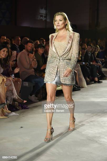 Kate Moss walks the runway at the Fashion for Relief event during the 70th annual Cannes Film Festival at Aeroport Cannes Mandelieu on May 21 2017 in...