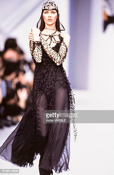 Kate Moss walks the runway at the Karl Lagerfeld Ready to Wear Fall/Winter 19931994 fashion show during the Paris Fashion Week in March 1993 in Paris...