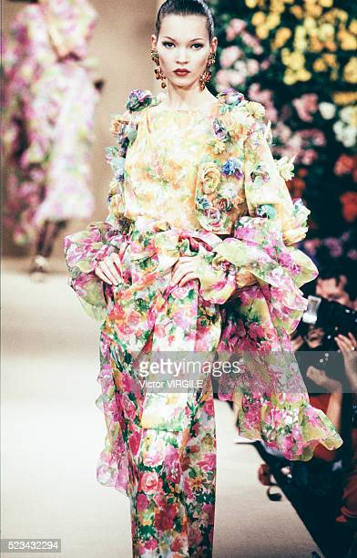 Kate Moss walks the runway at the Yves Saint Laurent Haute Couture Spring/Summer 1993 fashion show during the Paris Fashion Week in January, 1993 in...