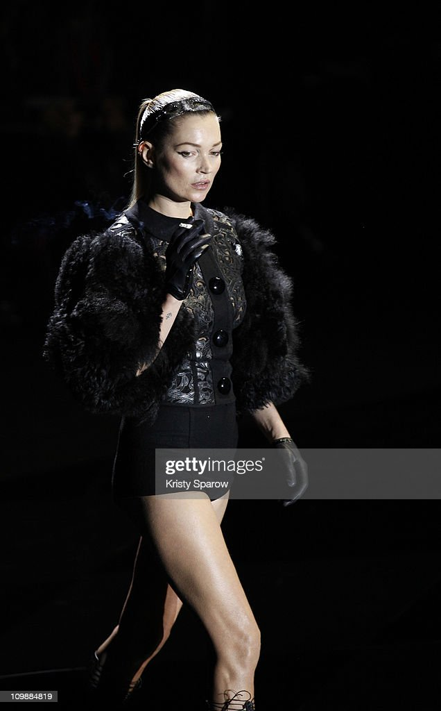 Kate Moss walks the runway during the Louis Vuitton Ready to Wear Autumn/Winter 2011/2012 show during Paris Fashion Week at Cour Carree du Louvre on March 9, 2011 in Paris, France.