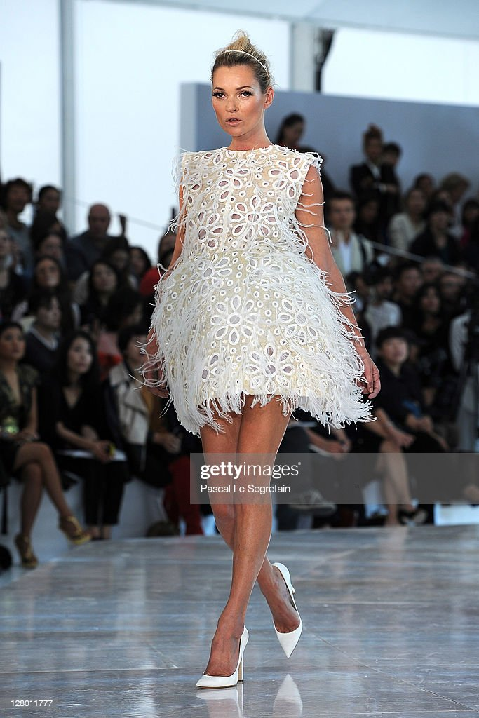 Kate Moss walks the runway during the Louis Vuitton Ready to Wear Spring / Summer 2012 show during Paris Fashion Week on October 5, 2011 in Paris, France.