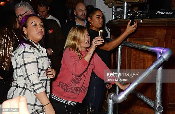 Kate Moss watches from the front row as Same Old Sean performs at the launch of his new EP 'Reckless' at Cafe KaiZen on November 13 2014 in London...