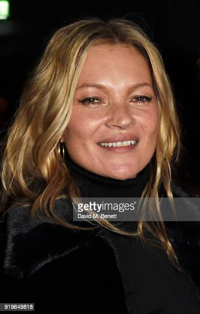 Kate Moss wearing Burberry at the Burberry February 2018 show during London Fashion Week at Dimco Buildings on February 17 2018 in London England