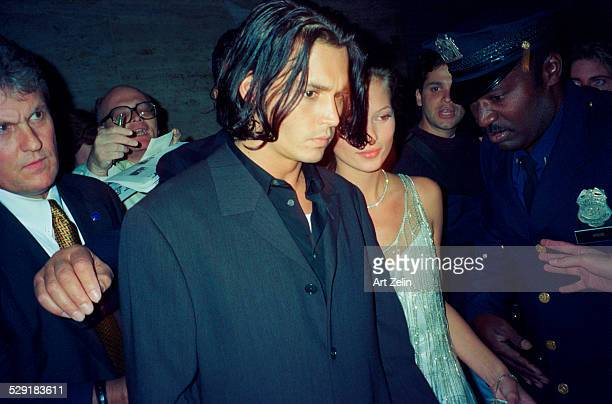 Kate Moss with Johnny Depp with security circa 1990 New York