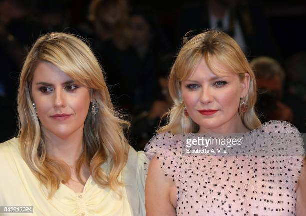 Kate Mulleavy and Kirsten Dunst walk the red carpet ahead of the 'Woodshock' screening during the 74th Venice Film Festival at Sala Giardino on...