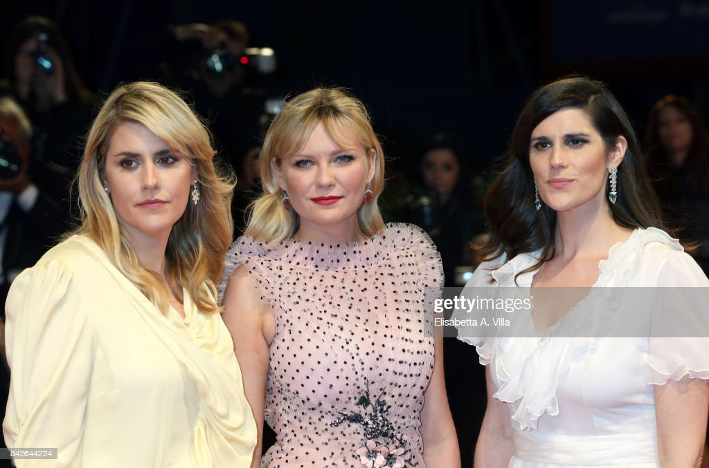 Kate Mulleavy, Kirsten Dunst and Laura Mulleavy walk the red carpet ahead of the 'Woodshock' screening during the 74th Venice Film Festival at Sala Giardino on September 4, 2017 in Venice, Italy.