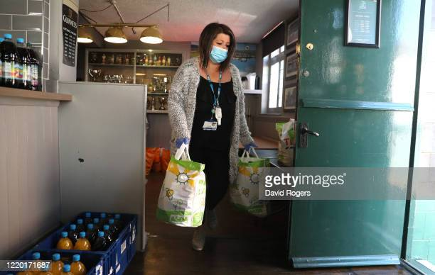 Kate Murby a Northampton NHS community mental health officer collects food bags at the food bank set up by public house owner Teresa McCarthyDixon at...