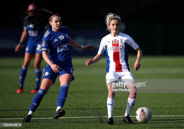 Kate Natkiel of Crystal Palace is tackled by Sam Tierney of Leicester City during the Barclays FA Women's Championship match between Leicester City...