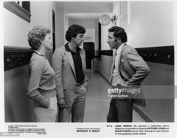 Kate Nelligan David Dukes talk with Judd Hirsch in a scene in the 20th Century Fox movie Without a Trace circa 1983