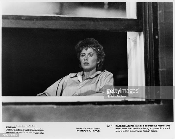 Kate Nelligan looks out a window in a scene in the 20th Century Fox movie Without a Trace circa 1983