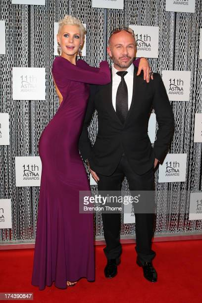 Kate Peck and Alex Perry arrive at the 11th Annual ASTRA Awards at The Sydney Theratre on July 25 2013 in Sydney Australia