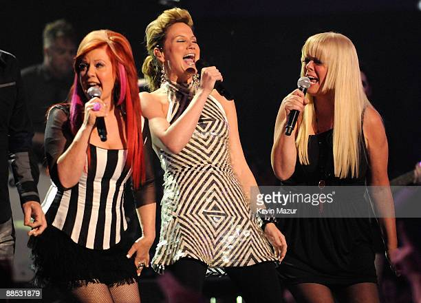 Kate Pierson of the B-52's, Jennifer Nettles of Sugarland and Cindy Wilson of the b-52's perform 'Love Shack' on stage at the 2009 CMT Music Awards...