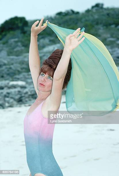Kate Pierson, singer and musician for the new wave group the B-52s, strikes a carefree pose on a beach.