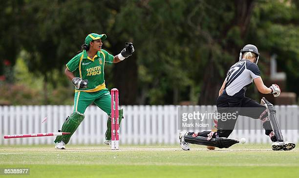 Kate Pulford of New Zealand is bowled Charlize van der Westhuizen of South Africa as Trisha Ghetty of South Afrcia celebrates during the ICC Women's...