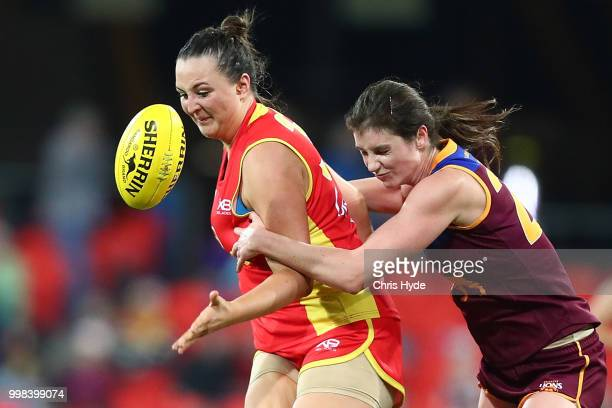 Kate Reyolds of the Suns is tackled by Sharni Webb of the Lions during the AFLW Winter Series match between the Gold Coast Suns and the Brisbane...