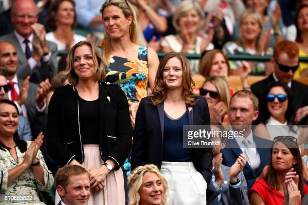 Kate RichardsonWalsh and Helen RichardsonWalsh are introduced to the crowd from the centre court royal box on day six of the Wimbledon Lawn Tennis...