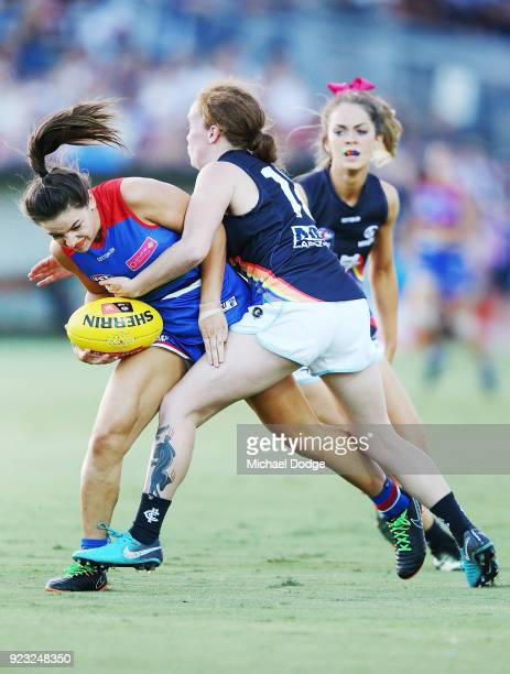 Kate Shierlaw of the Bulldogs is tackled by KatieJayne Grieve of the Blues during the round four AFLW match between the Western Bulldogs and the...