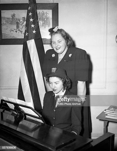 Kate Smith with piano accompanist prepares to perform on The Kate Smith Hour radio program from the United States Navy Yard Philadelphia PA Image...