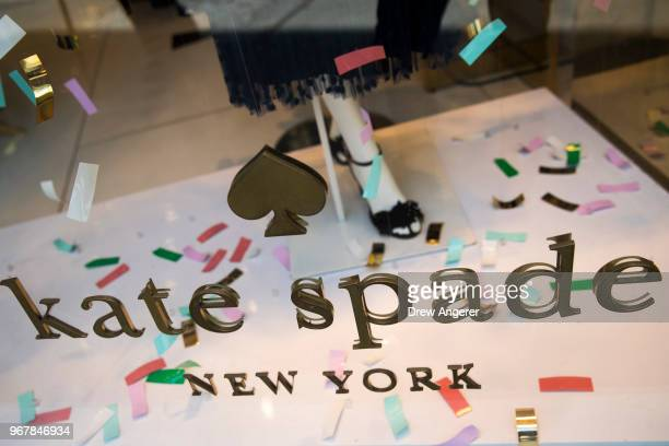 Kate Spade logo is seen on a Madison Avenue storefront City after fashion designer Kate Spade was found dead in her apartment of an apparent suicide...