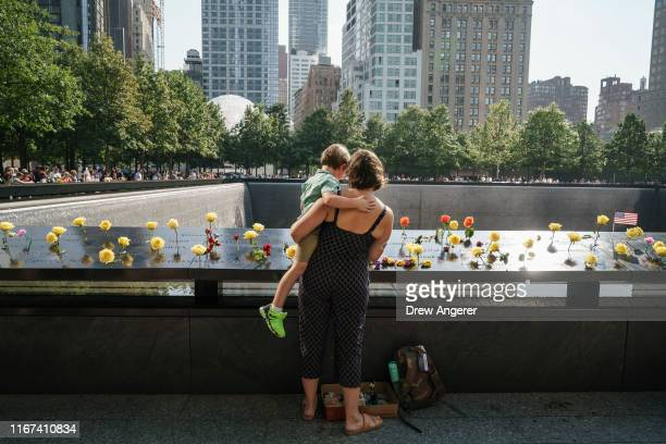 Kate Sylvain and her son Francis visit the National September 11 Memorial on the 18th anniversary of the 9/11 attacks September 11 2019 in New York...