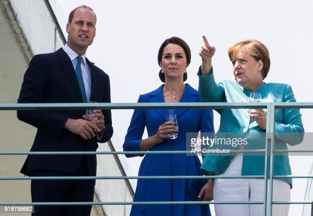 Kate the Duchess of Cambridge waves as she meets with her husband Britain's Prince William Duke of Cambridge the German Chancellor Angela Merkel in...