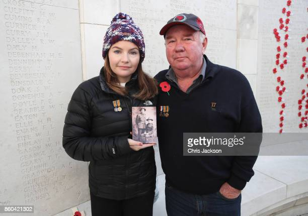 Kate Thomas and her father Jim Kiesanowski with a photograph of her grandfather Morris Crimmins and her great uncle John Patrick killed in action...