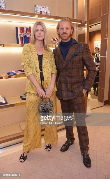 Kate Tik and Alistair Guy attend the Salvatore Ferragamo Old Bond Street 80th Anniversary Cocktail on November 8 2018 in London England