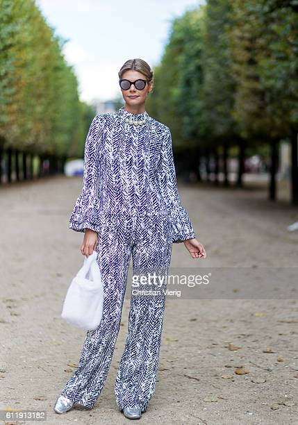 Kate Tikhomirova wearing top and trouser suit from Adolfo Dominquez shoes Dorateymur mink patata bag in the color temperature necklace kenneth jay...