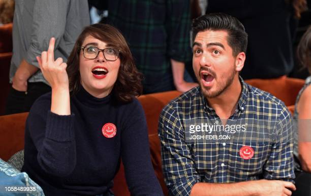 Kate Tores and Cris Aragon react as CNN announces Ted Cruz wins re-election for Senate in Texas during an election viewing party at a bar in San...