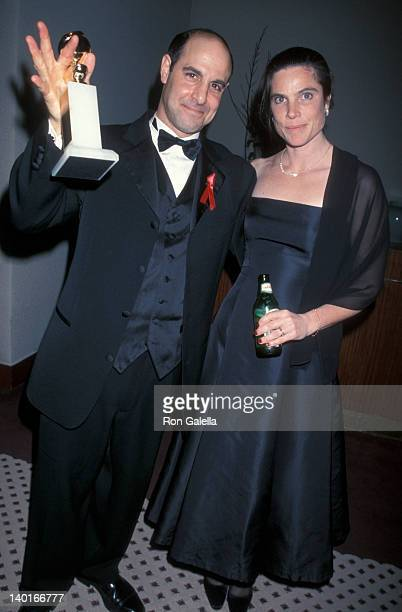 Kate Tucci and Stanley Tucci with an award at the 56th Annual Golden Globe Awards Beverly Hills