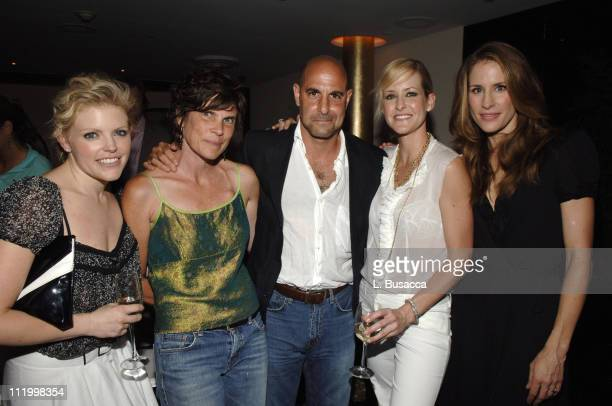 Kate Tucci and Stanley Tucci with Natalie Maines Martie Maguire and Emily Robison of the Dixie Chicks