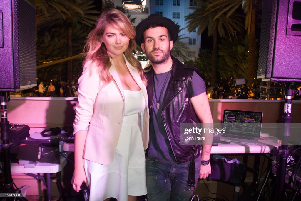 Kate Upton and A-Trak attend the EXPRESS South Beach at The Raleigh Hotel on March 13, 2014 in Miami, Florida.