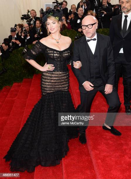 Kate Upton and Domenico Dolce attend the 'Charles James Beyond Fashion' Costume Institute Gala at the Metropolitan Museum of Art on May 5 2014 in New...